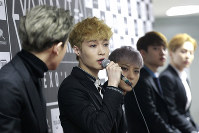 In this March 8, 2015 file photo, South Korean K-pop group EXO member Lay, second from left, speaks during a press conference in Seoul, South Korea. (AP Photo/Ahn Young-joon)