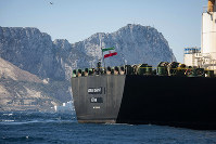 Renamed Adrian Aryra 1 super tanker hosting an Iranian flag sails in the waters in the British territory of Gibraltar, on Aug. 18, 2019. (AP Photo/Marcos Moreno)
