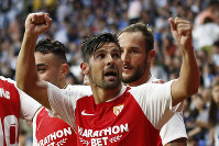 Sevilla's Nolito celebrates with team mates after scoring his side's second goal during the Spanish La Liga soccer match between Espanyol and Sevilla at the RCDE Stadium in Barcelona, Spain, on Aug.18, 2019. (AP Photo/Joan Monfort)