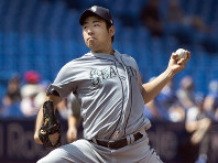 Seattle Mariners starting pitcher Yusei Kikuchi throws against the Toronto Blue Jays during the seventh inning a baseball game in Toronto, on Aug. 18, 2019. (Fred Thornhill/The Canadian Press via AP)