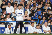 Chelsea's head coach Frank Lampard stands by the bench after Leicester tied the game 1-1 during the English Premier League soccer match between Chelsea and Leicester City at Stamford Bridge stadium in London, on Aug. 18, 2019. (AP Photo/Frank Augstein)