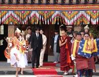 Crown Prince Akishino, Crown Princess Kiko and their son Prince Hisahito go through a courtyard at the Tashichho Dzong castle to meet Bhutanese King Jigme Khesar Namgyel Wangchuck and his wife Jetsun Pema in Thimphu, Bhutan, on Aug. 19, 2019. (Pool photo)