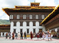 Crown Prince Akishino, Crown Princess Kiko and their son Prince Hisahito go through a courtyard at the Tashichho Dzong castle, which accommodates government departments, temples and other facilities, to meet Bhutanese King Jigme Khesar Namgyel Wangchuck and his wife Jetsun Pema in Thimphu, Bhutan, on Aug. 19, 2019. (Pool photo)