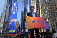 Javier Bardem poses for a photo in Times Square in New York, on Aug. 19, 2019. (AP Photo/Claudia Torrens)