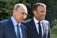 French President Emmanuel Macron, right, welcomes Russian President Vladimir Putin at the Fort of Bregancon in Bormes-les-Mimosas, southern France, on Aug. 19, 2019. (Gerard Julien, Pool via AP)