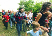This picture taken Aug.19, 1989 shows East Germans surprise Hungarian border guards and rush through a gate into Moerbisch, Austria. The gate was opened as part of joint Austrian-Hungarian event, marking the end of the Iron Curtain. The East Germans had heard of the event and used it for their flight to the West. (AP-Photo/votava)