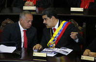 In this Jan. 24, 2019 file photo, Venezuelan President Nicolas Maduro, right, speaks with Constitutional Assembly President Diosdado Cabello at the Supreme Court during an annual ceremony that marks the start of the judicial year in Caracas, Venezuela. (AP Photo/Ariana Cubillos)
