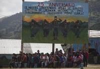 In this Jan. 1, 2019 file photo, members of the Zapatista National Liberation Army, EZLN, attend an event marking the 25th anniversary of the Zapatista uprising in La Realidad, Chiapas, Mexico. (AP Photo/Eduardo Verdugo)