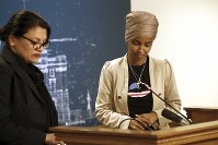 Rep. Ilhan Omar, D-Minn., right, and Rep. Rashida Tlaib, D-Mich., take a quiet moment as they talked about Israel's refusal to allow them to visit the country during a news conference, on Aug. 19, 2019 at the State Capitol in St. Paul, Minn. (AP Photo/Jim Mone)