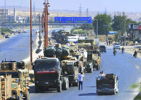 A Turkish army convoy is seen at a highway between Maaret al-Numan and Khan Sheikhoun in Idlib province, Syria, on Aug. 19, 2019. (Murat Kibritoglu/DHA via AP)