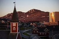 In this July 31, 2017 file photo, the sun sets over Nuuk, Greenland. (AP Photo/David Goldman)