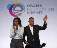 In this Oct. 13, 2017 file photo, former President Barack Obama, right, and former first lady Michelle Obama arrive for the first session of the Obama Foundation Summit in Chicago. (AP Photo/Charles Rex Arbogast)