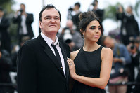 In this May 18, 2019 file photo, film director Quentin Tarantino and his wife Daniela Pick pose for photographers upon arrival at the premiere of the film