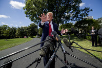 President Donald Trump speaks with reporters before departing on Marine One on the South Lawn of the White House, on Aug. 21, 2019, in Washington. (AP Photo/Alex Brandon)