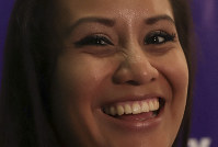Evelyn Beatriz Hernandez, a 21-year-old Salvadoran woman who was originally sentenced to 30 years in prison for aggravated homicide after suffering a miscarriage in 2016, smiles as she answers questions from journalists two days after her acquittal on retrial, at the offices of Colectivo Feminista in San Salvador, El Salvador, on Aug. 21, 2019. (AP Photo/Salvador Melendez)
