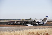 The burned out remains of a twin-engine Cessna Citation is seen at the end of a runway after the pilot aborted the takeoff at the Oroville Airport in Oroville, California, on Aug. 21, 2019. (AP Photo/Rich Pedroncelli)