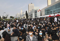 Students and others gather during a demonstration at Edinburgh Place in Hong Kong, on Aug. 22, 2019. (AP Photo/Vincent Yu)