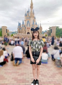 This photo posted by swimming star Rikako Ikee on her Instagram account shows her posing in front of Cinderella Castle at Tokyo Disneyland. (Photo via Instagram)