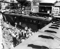 In this July 15, 1949 file photo, a runaway train is seen after plowing into several buildings including a home in Mitaka, a suburb in western Tokyo. (Mainichi)