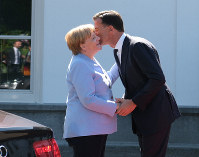 Dutch Prime Minister Mark Rutte, right, greets German Chancellor Angela Merkel in The Hague, Netherlands, on Aug. 22, 2019.(AP Photo/Mike Corder)