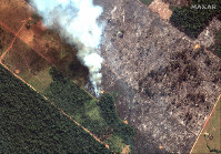 This Aug. 15, 2019 satellite image from Maxar Technologies shows closeup view of a fire southwest of Porto Velho Brazil. (Maxar Technologies via AP)