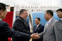 In this July 6, 2018 file photo, U.S. Secretary of State Mike Pompeo, second from left, is greeted by North Korean Director of the United Front Department Kim Yong Chol, center, and North Korean Foreign Minister Ri Yong Ho, second from right, as he arrives at Sunan International Airport in Pyongyang, North Korea. (AP Photo/Andrew Harnik, Pool)