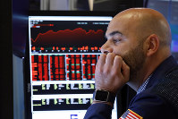 Trader Fred DeMarco works on the floor of the New York Stock Exchange, on Aug. 23, 2019. (AP Photo/Richard Drew)