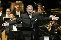 In this Jan. 22, 2004, file photo, Placido Domingo sings during his performance at the National Theater in Santiago, Dominican Republic. (AP Photo/Miguel Gomez)