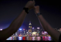 Demonstrators link hands as they gather at the Tsim Sha Tsui waterfront in Hong Kong, on Aug. 23, 2019. (AP Photo/Vincent Yu)