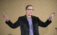 In this Aug. 19, 2016, file photo U.S. Supreme Court Justice, Ruth Bader Ginsburg, is introduced during the keynote address for the State Bar of New Mexico's Annual Meeting in Pojoaque. (AP Photo/Craig Fritz)