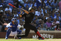 Washington Nationals' Juan Soto, right, hits a home run in the seventh inning of a baseball game against the Chicago Cubs, Aug. 23, 2019, in Chicago. (AP Photo/Matt Marton)