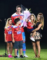 Soccer player Fernando Torres of Sagan Tosu receives a bouquet from his family at his retirement ceremony at Ekimae Real Estate Stadium on Aug. 23, 2019. (Mainichi/Tomohisa Yazu)