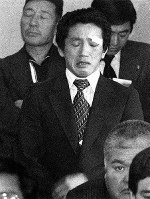 1980 Moscow Olympics -- Japanese wrestler Yuji Takada cries as he appeals for Japan to participate in the games at a meeting between athletes and staff on April 21, 1980.