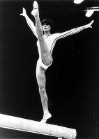 1980 Moscow Olympics -- Nadia Comaneci, of Romania, performs on the balance beam in the women's gymnastics. She won two gold and two silver medals at the games.