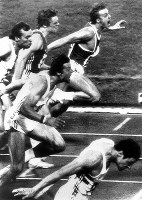 1980 Moscow Olympics -- Allan Wells, of Britain, front, crosses the finish line in first place with a time of 10.25 seconds in the men's 100 meters. Wells performed strongly despite Cold War Communist countries capturing many medals.