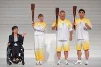 The uniforms for the 2020 Tokyo Paralympic torch relay are revealed during a ceremony to mark one year before the games begin at NHK Hall in Tokyo's Shibuya Ward on Aug. 25, 2019. From left, official ambassador Aki Taguchi, actress Satomi Ishihara, and comedy duo Mikio Date and Takeshi Tomizawa are seen. (Mainichi/Koichiro Tezuka)