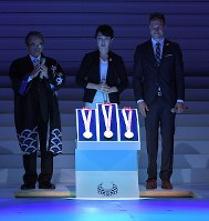 The medals for the 2020 Tokyo Paralympics are revealed during a ceremony to mark one year before the games begin at NHK Hall in Tokyo's Shibuya Ward on Aug. 25, 2019. From left, Ryohei Miyata, commissioner for Cultural Affairs, medal designer Sakiko Matsumoto and Markus Rehm, a German long jumper with an artificial leg, are seen. (Mainichi/Koichiro Tezuka)