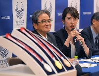 Sakiko Matsumoto, who designed the medals for the 2020 Tokyo Paralympics, speaks at a press conference to reveal the medals at NHK Hall in Tokyo's Shibuya Ward on Aug. 25, 2019. (Mainichi/Koichiro Tezuka)