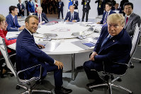 French President Emmanuel Macron, center left, and US President Donald Trump, center right, participate in a G-7 Working Session on the Global Economy, Foreign Policy, and Security Affairs the G-7 summit in Biarritz, France, on Aug. 25, 2019. (AP Photo/Andrew Harnik, Pool)