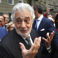 Placido Domingo talks to fans at the 'Festspielhaus' opera house after he performed 'Luisa Miller' by Giuseppe Verdi in Salzburg, Austria, on Aug. 25, 2019. (AP Photo/Matthias Schrader)