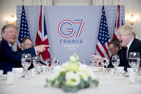 U.S. President Donald Trump, left, and Britain's Prime Minister Boris Johnson attend a working breakfast at the Hotel du Palais on the sidelines of the G-7 summit in Biarritz, France, on Aug. 25, 2019. (AP Photo/Andrew Harnik)
