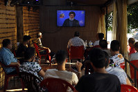 People listen to a speech by Hezbollah leader Sayyed Hassan Nasrallah broadcasted on Hezbollah's al-Manar TV channel, at a coffee shop in a southern suburb of Beirut, Lebanon, on Aug. 25, 2019. (AP Photo/Bilal Hussein)