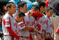 The Little League team from Japan lines up to salute their fans after a 5-4 loss to Curacao in the International Championship baseball game at the Little League World Series tournament in South Williamsport, Pa., on Aug. 24, 2019. (AP Photo/Gene J. Puskar)