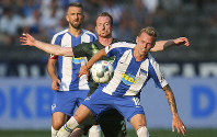 Maximilian Arnold from VfL Wolfsburg, center, and Berlin's Ondrej Duda, front, battle for the ball during the German Bundesliga soccer match between VfL Wolfsburg and Hertha BSC Berlin in Berlin, Germany, on Aug. 25, 2019. (Andreas Gora/dpa via AP)