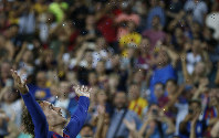 Barcelona's Antoine Griezmann celebrates after scoring his side's second goal during the Spanish La Liga soccer match between FC Barcelona and Betis at the Camp Nou stadium in Barcelona, Spain, on Aug. 25, 2019. (AP Photo/Joan Monfort)