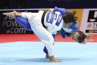 Funa Tonaki of Japan, front, competes against Distria Krasniqi of Kosovo during a women's -48 kilogram Semi-final of the World Judo Championships in Tokyo, on Aug. 25, 2019. (AP Photo/Koji Sasahara)