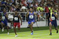 Abdul Hakim Sani Brown of Japan, third from left, runs during the 100m race at the Meeting Madrid athletics tournament at the Vallehermoso stadium in Madrid, Spain, on Aug. 25, 2019. (AP Photo/Paul White)