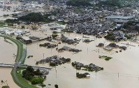 Residential areas are seen flooded from a Mainichi Shimbun helicopter in the city of Takeo, Saga Prefecture, in the northern Kyushu region on Aug. 28, 2019. (Mainichi/Toyokazu Tsumura)