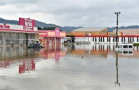 The parking area of a shopping center is seen flooded in the city of Takeo, Saga Prefecture, in the northern Kyushu region on Aug. 28, 2019. (Mainichi/Michiko Morizono)
