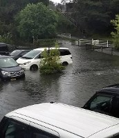 A parking area is seen flooded due to heavy rain in the city of Takeo, Saga Prefecture, in the northern Kyushu region on Aug. 28, 2019. (Photo courtesy of a reader)